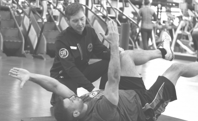 A personal trainer working with client during personal training session