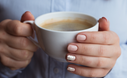 Woman's hands holding coffee mug