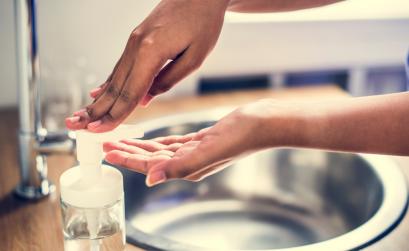 Woman washing hands at sick