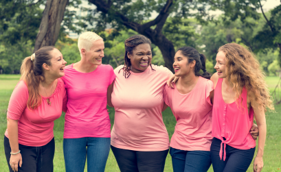 Group of diverse women wearing pink