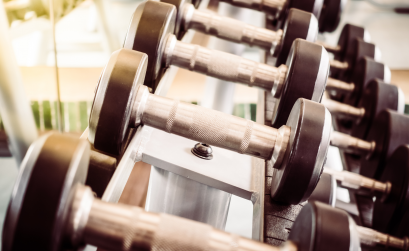 Photo of dumbbells on a weight rack
