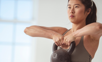 Woman lifting heavy kettlebell
