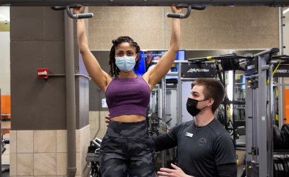 Krys Rollins performing a pull up