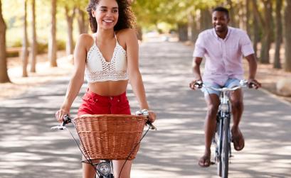 Man and woman biking outside
