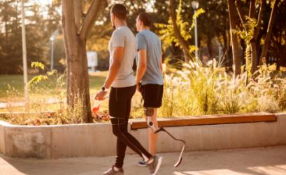 Two men walking outside in the sunshine
