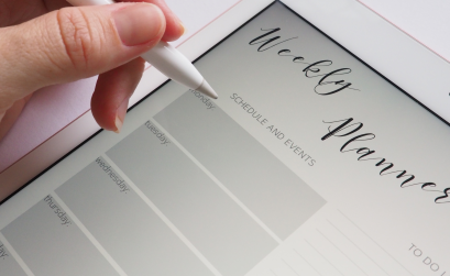Photo of a hand hovering over an electronic weekly planner