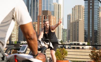 Man teaching outdoor spin class